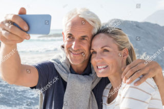 stock image of a couple taking a photo together