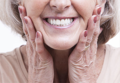 woman-holding-face-smiling.jpg